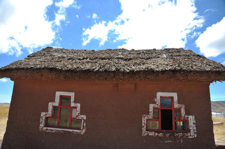 vastness: The roof of reeds in Bolivian mountain village in the vastness of the Altiplano