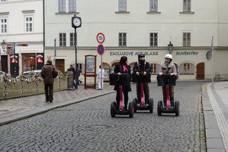 praga: Tourists on Segways on the streets of Prague.