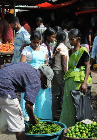 residents: Residents in the market of Kandy.