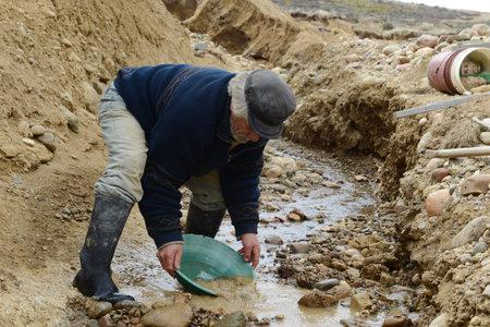 tierra del fuego: Miner washing gold in Tierra del Fuego.