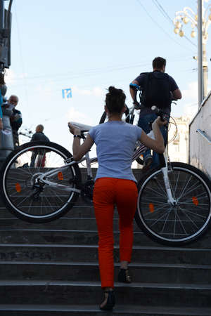 heaviness: The cyclist rises from the underpass.