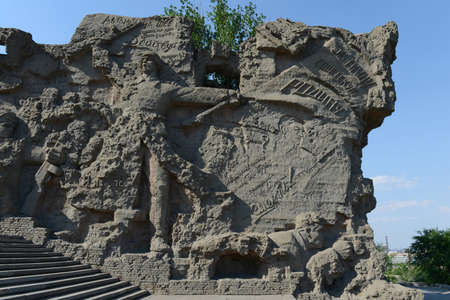 the great wall and the fall: The bas-relief on the walls-the ruins of the monument-ensemble to Heroes of Stalingrad battle on Mamaev Kurgan in Volgograd.