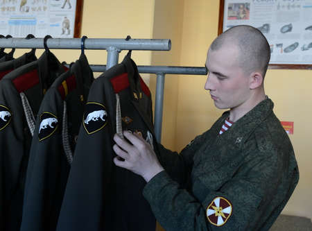 dormitories: Military personnel of internal troops prepare form for the parade.