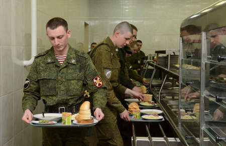 Soldiers have lunch in canteens.