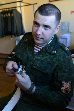 dormitories: The serviceman of internal troops prepares the form for the parade