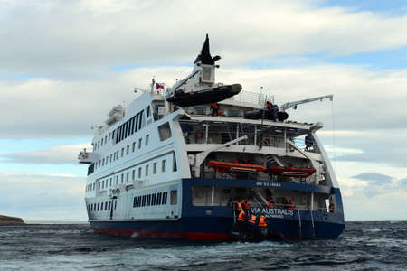 disembark: Tourists disembark from cruise ship on the Chilean island of Magdalena. Editorial