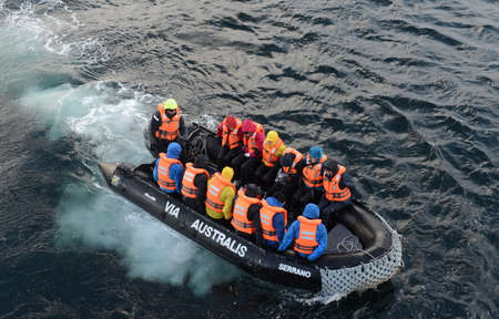 via: Tourists disembark from cruise ship Via Australis on Cape horn. Editorial