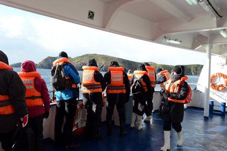 disembark: Tourists disembark from cruise ship Via Australis on Cape horn