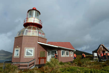 tierra: Famous lighthouse at Cape Horn - the southernmost point of the archipelago of Tierra del Fuego, washed by the waters of the Drake passage.