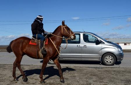 rio: The Gauchos are riding along the road in Rio Grande. Editorial