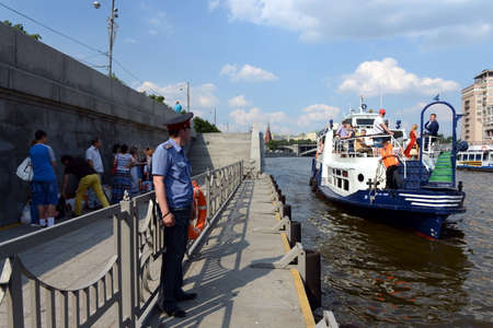 pleasure boat: Pleasure boat moored to the pier on the Moscow river. Editorial