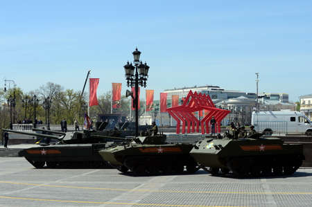 rehearsal: Rehearsal of parade in honor of Victory Day in Moscow. The latest main battle T-14 Armata heavy tracked platform.Fighting machine landing BMD-4M. BTR-MDM Rakushka.