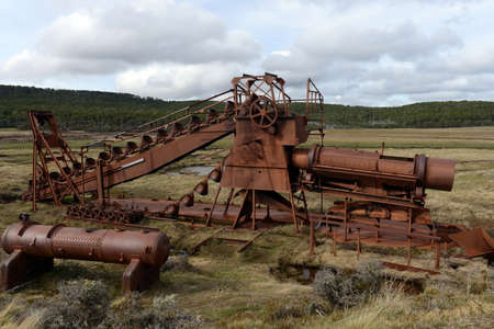 prospector: Abandoned gold mine at lake Lago Blanco. English mechanical dredge was engaged in gold mining from 1904 to 1910. Stock Photo
