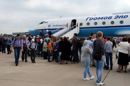examine: Visitors examine the plane Yak-40 at the International Aviation and Space salon MAKS-2013. Editorial