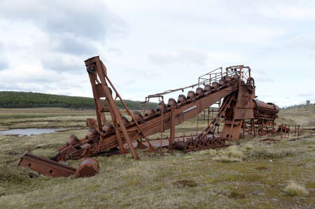gold shovel: Abandoned gold mine at lake Lago Blanco. English mechanical dredge was engaged in gold mining from 1904 to 1910. Stock Photo