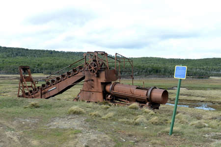 blanco: Abandoned gold mine at lake Lago Blanco. English mechanical dredge was engaged in gold mining from 1904 to 1910. Stock Photo