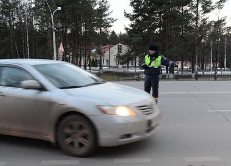 The inspector of traffic police stops the car.