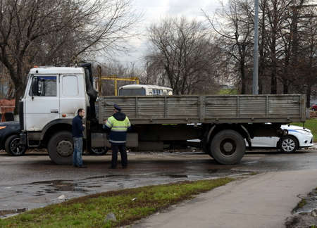 truck driver: The inspector of traffic police talking to a truck driver.