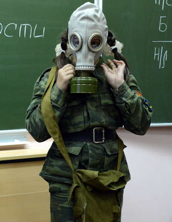 livelihoods: Training putting on the gas mask in the cadet corps of the police.