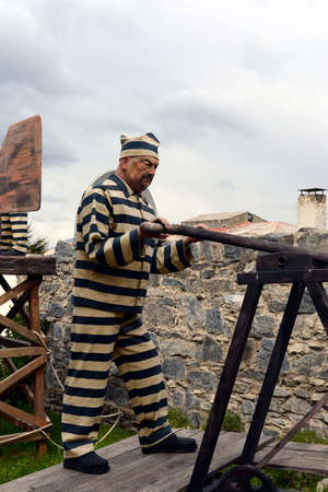 narrow gauge railways: Sculpture of convicts in Ushuaia. Editorial