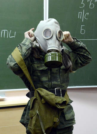 livelihoods: Training putting on the gas mask. Editorial