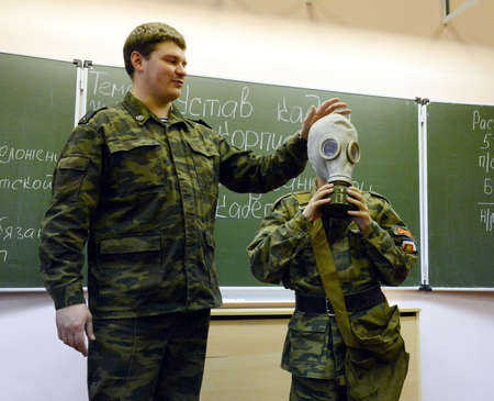 livelihoods: Training putting on the gas mask Editorial