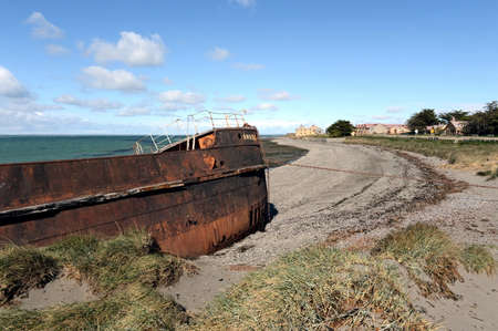 magallanes: Rusty ship on the shore of the Strait of Magellan in the village of San Gregorio.