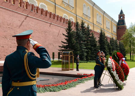 tomb unknown soldier: The ceremony of laying flowers and wreaths at the Tomb of the Unknown Soldier during Victory Day celebrations. Editorial