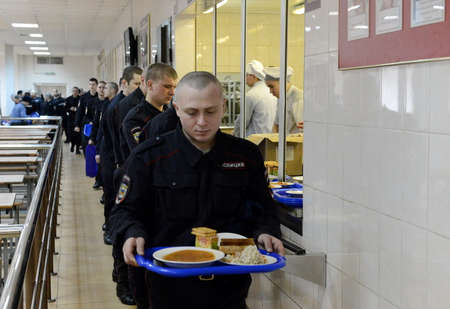 soldiers: Soldiers have lunch in canteens.