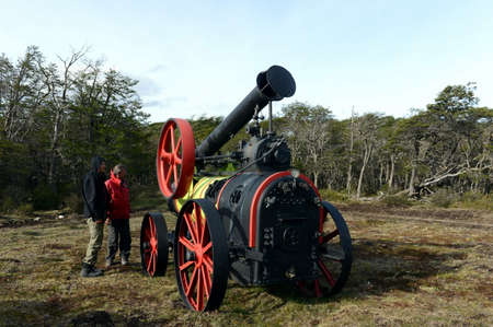 fuego: Tourists at the steam threshers in Tierra del Fuego. Editorial