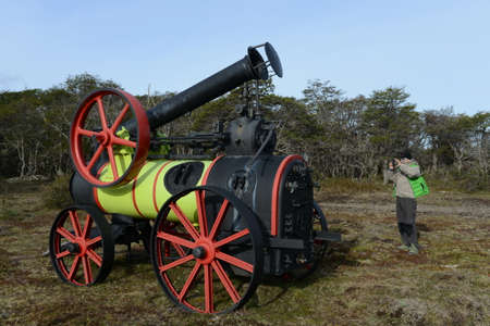 fuego: Tourist at the steam threshers in Tierra del Fuego. Editorial