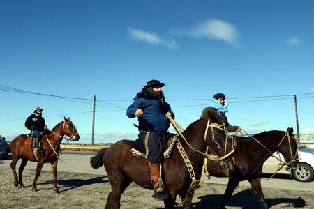 grande: The Gauchos are riding along the road in Rio - Grande. Editorial
