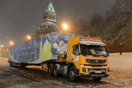 Shipping main all-Russian Christmas tree in the Kremlin on the cargo trailer. Editorial