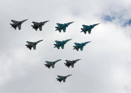 maneuverable: A group of fighter planes su-34, su-27 and SU-35S