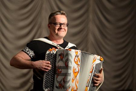 fames: Russian musician, accordionist Sergei Voitenko.