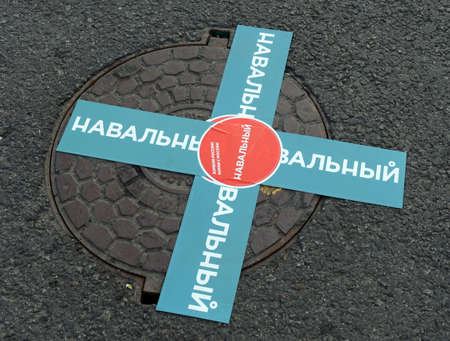 Stickers on the hatch at a rally in support of Alexei Navalny on Bolotnaya square in Moscow.