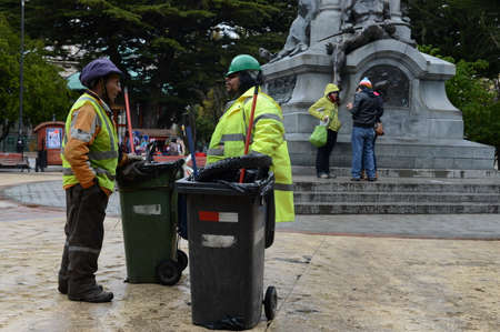 Garbage cleaners in Punta Arenas. Editorial