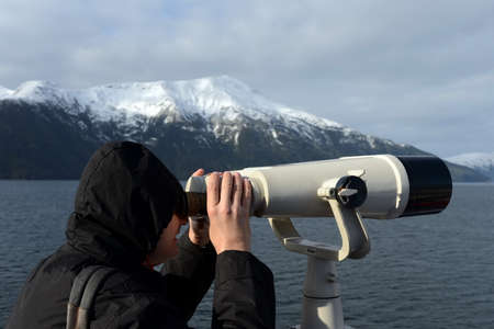 considers: The tourist considers the Pia glacier from the deck of a passenger vessel. Editorial