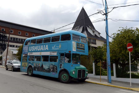 Double Decker bus on the street of Ushuaia. Editorial