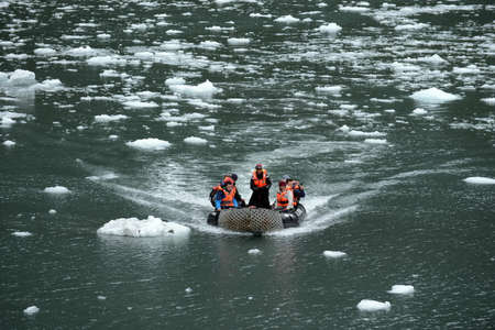 Tourists from the cruise ship in the Garibaldi fjord in the archipelago of Tierra del Fuego. Editorial