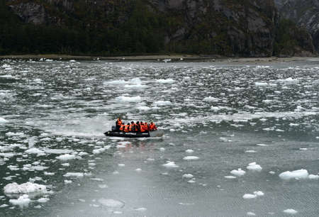 magallanes: Tourists from the cruise ship in the Garibaldi fjord in the archipelago of Tierra del Fuego. Editorial