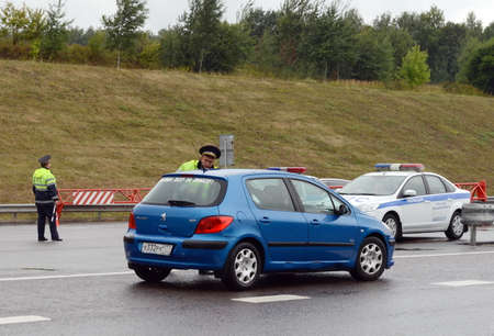 The inspector of traffic police check the documents of the driver on the track Don. Editorial