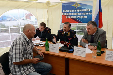 jurists: The police major general Vladimir Kuzin and the rector of legal university Victor Blazheev conduct reception of drivers in an exit reception of public council.