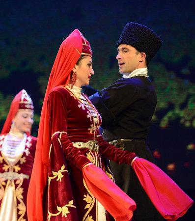 circassian: Ossetians in traditional dress dancing folk mountain dance. Editorial