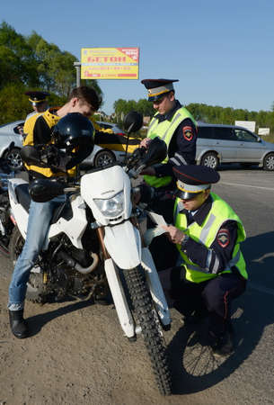 Employees of the traffic police service check of motorcyclists on the road. Editorial