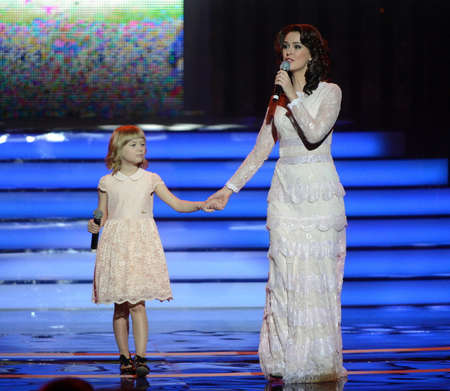 Actress Alena Bikkulova and finalist of the Voice-kids Yaroslav Degtyarev at the ceremony of awarding the winners of the warm heart.