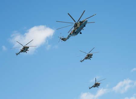 Group of helicopters Mi-26 and Mi-8 AMTSH (Mi-171SH) is flying in the sky over red square during a rehearsal of the Victory parade.