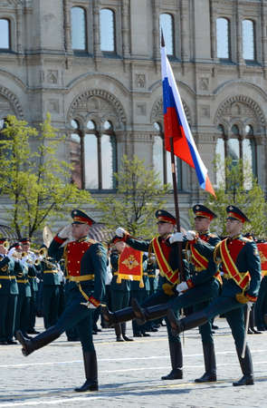 Soldiers of the honor guard special commandant of the Preobrazhensky regiment carry the Russian flag at the rehearsal of the military parade on red square.