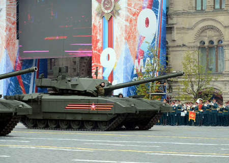 tracked: The newest Russian main battle T-14 Armata heavy tracked platform during the Victory day parade on red square.
