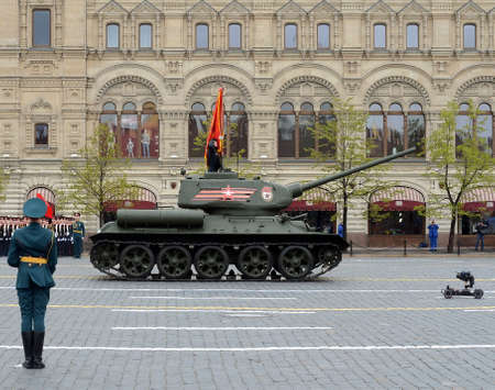 Medium tank T-34-85 with red flags on red square during a parade marking the 72nd anniversary of the Victory in the Great Patriotic war. Editorial